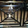 wrought iron handrail with brass rail cap and brass rosettes