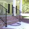 Modified Birmingham Style Handrail with round collars and scrolled volutes.  Also seen here with cover shoes at the base of the posts, which hides the mounting hardware and creates a more finished look.